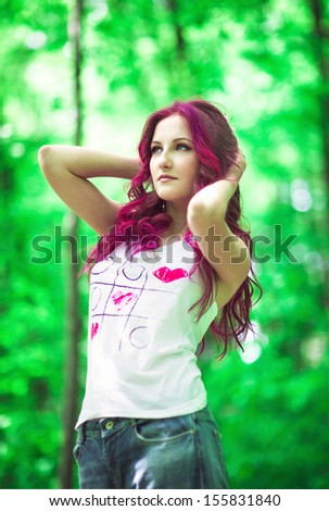 Beautiful young woman with pink hair - stock photo