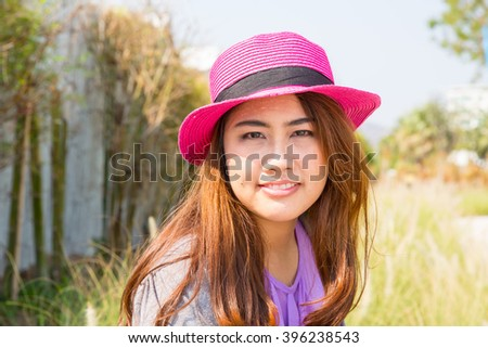 Beautiful young woman with pink hat.
