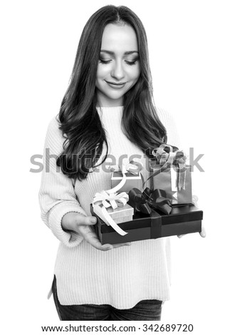 beautiful young woman with red hair cheerfully posing with christmas present isolated on white
