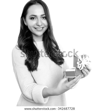 beautiful young woman with red hair posing cheerfully with presents for christmas