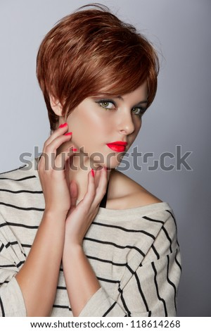 ... red hair wearing short pixie crop hairstyle on studio background