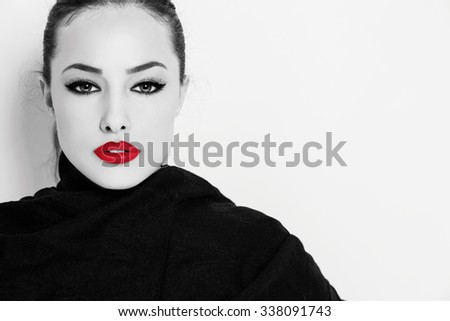 beautiful young woman with red lips and big black eyelashes