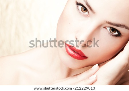 beautiful young woman with red lips, studio shot