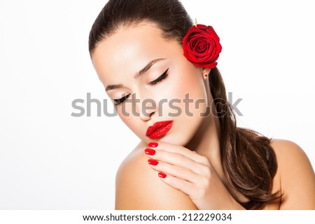 beautiful young woman with red lipstick and nail polish, studio white - stock photo
