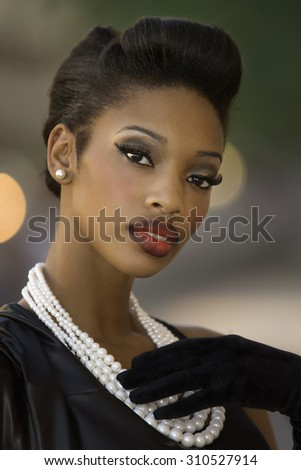 Beautiful young woman with retro vintage short hairstyle - stock photo