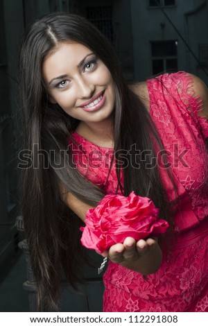 Beautiful Young  Woman with Rose and green eyes - stock photo