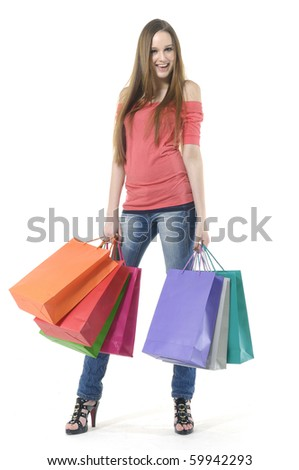 Beautiful young woman with shopping bags - stock photo
