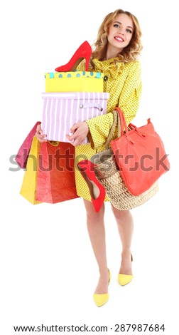 Beautiful young woman with shopping bags and shoes isolated on white