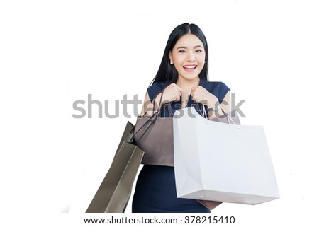 Beautiful young woman with shopping bags isolated on white (with clipping path) - stock photo