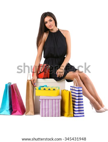 Beautiful young woman with shopping  isolated on white