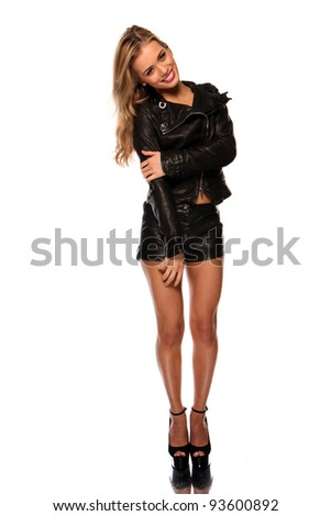 Beautiful young woman with shorts and leather jacket