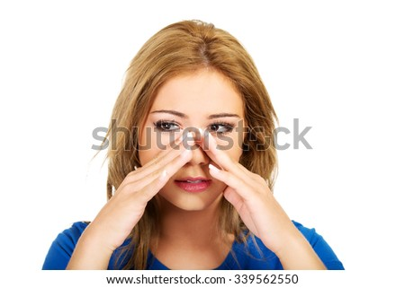 Beautiful young woman with sinus pressure pain. - stock photo