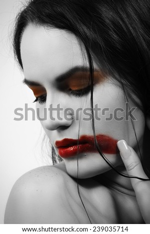 beautiful young woman with smeared lipstick