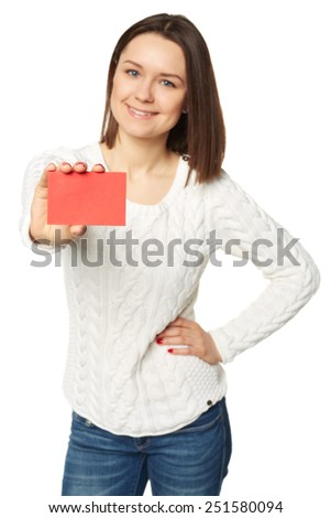 Beautiful young woman with smile displaying blank business card. Shallow depth of field, focus on card. - stock photo
