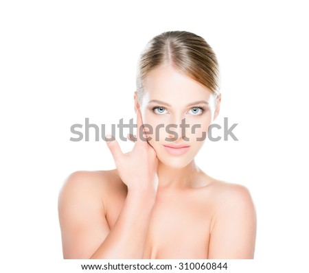 Beautiful young woman with smooth skin on isolated background. - stock photo