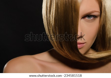 Beautiful young woman with straight hair on black background - stock photo