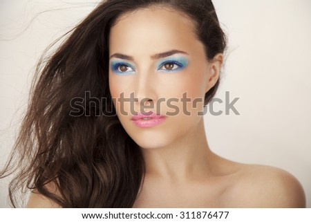 beautiful young woman with summer makeup, studio white