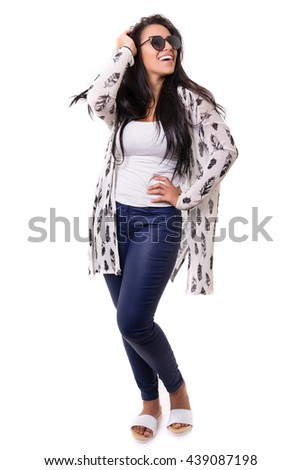 Beautiful young woman with sunglasses posing in studio, isolated over white