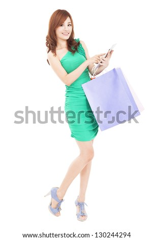 beautiful young woman with tablet pc and shopping bag - stock photo