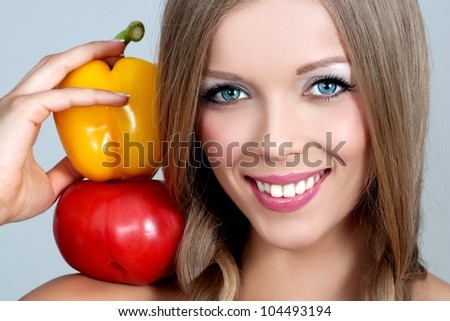 beautiful young woman with vegetables