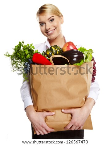 beautiful young woman with vegetables and fruits in shopping bag , isolated on white