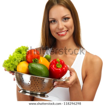 beautiful young woman with vegetables in colander, isolated on white