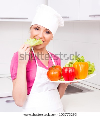 beautiful young  woman with vegetables in the kitchen