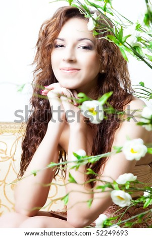 beautiful young woman with white lowers