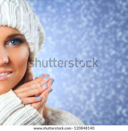 beautiful young woman with white sweater and cap