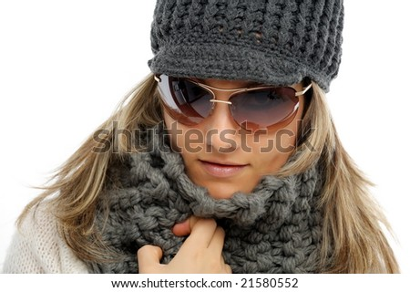 beautiful young woman with winter clothes and sunglasses - stock photo