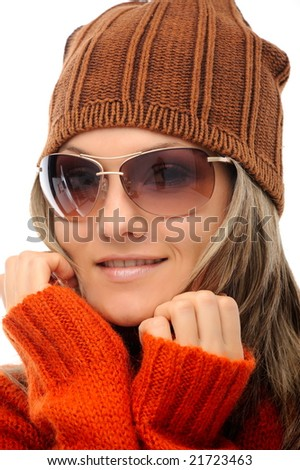 beautiful young woman with winter clothes and sunglasses