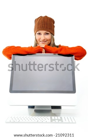 beautiful young woman with winter clothes leaning against computer