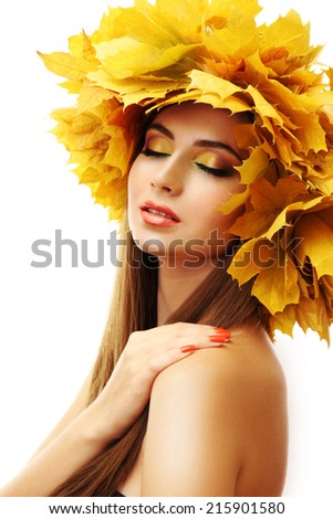 Beautiful young woman with yellow autumn wreath, isolated on white - stock photo