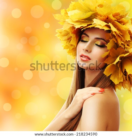 Beautiful young woman with yellow autumn wreath on bright background - stock photo