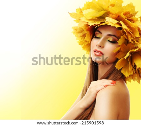 Beautiful young woman with yellow autumn wreath on yellow background - stock photo