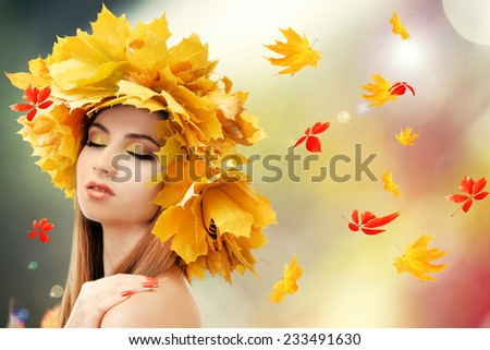 Beautiful young woman with yellow autumn wreath outdoors - stock photo