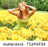 beautiful young woman with yellow tulips - stock photo