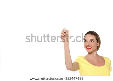 Beautiful young woman writing on glass - isolated on a white - stock photo