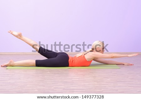 Beautiful young women doing Pilates exercise - stock photo