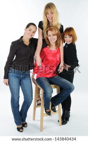 Beautiful young women friends together in studio