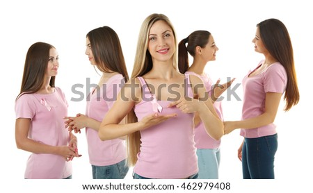 Beautiful young women in pink shirts on white background. Breast cancer concept