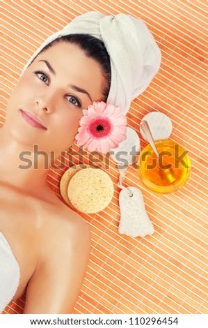 Beautiful young women in spa - stock photo
