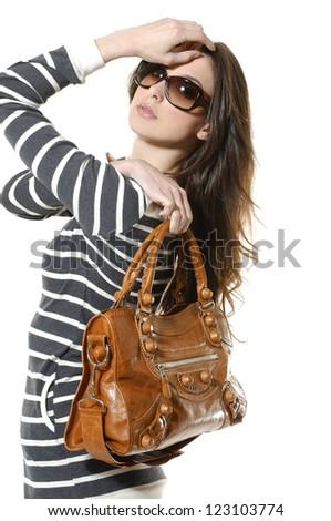 beautiful young women in sunglasses with her handbag posing - stock photo