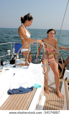 Beautiful young women out at sea on a yacht