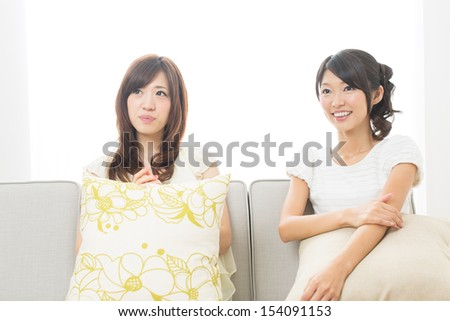 Beautiful young women relaxing in the room