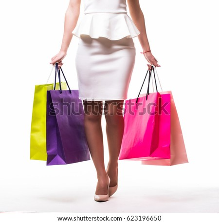Beautiful young women with bags, shopping concept, isolated on white background