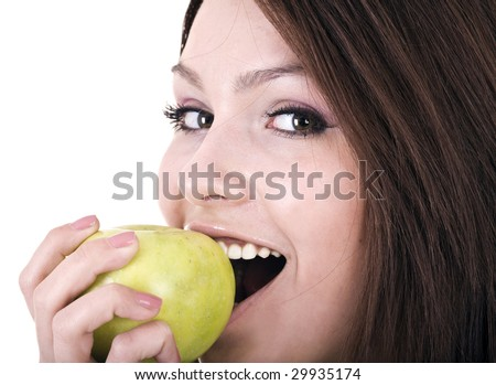 Beautiful young women with green apple. Isolated - stock photo