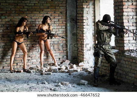 Beautiful young women with rifles and soldier