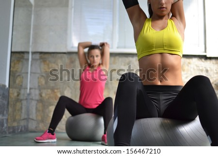 beautiful young women working out in the fitness studio - stock photo