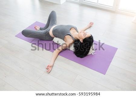 beautiful young yoga girl lying asana stock photo